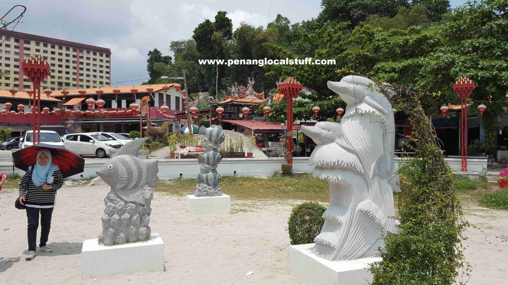 Statues Of Fishes And Dolphins At Tua Pek Kong Temple