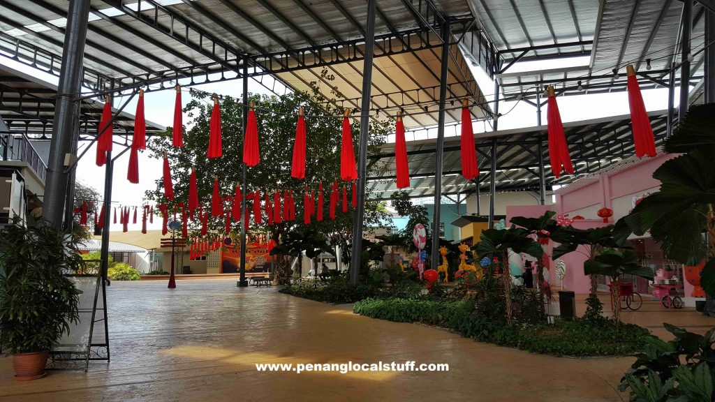 New World Park Pathway With Hanging Red Cloths